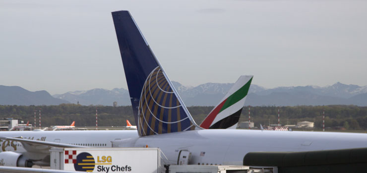 Rival United and Emirates B777s at Milan Malpensa Airport.  Lowell Silverman photography, 2015