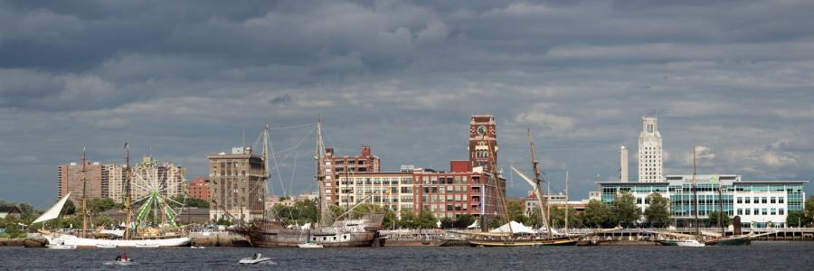 Tall ships across the Delaware River in Camden, New Jersey as seen from Penn's Landing