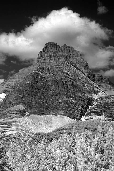 Mt. Wilbur in infrared seen from near where the connector trail from Swiftcurrent Motor Inn meets the main trail. Iceberg lake sits on the far side of the mountain. Lowell Silverman photography, 2014