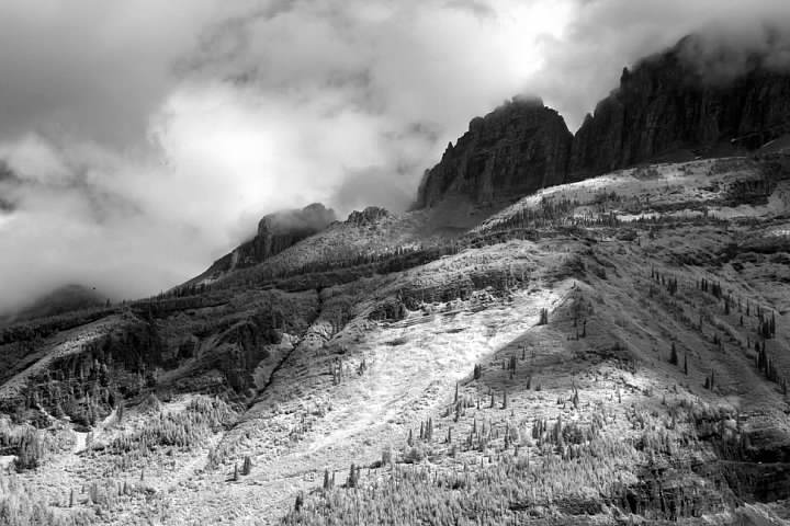 The Garden Wall seen from the Going-to-the-Sun Road in the Lake McDonald Valley.  A stretch of road further east is barely visible at lower right.  Infrared photo
