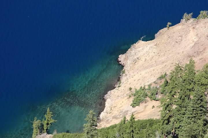 Blue water of Crater Lake seen from the rim