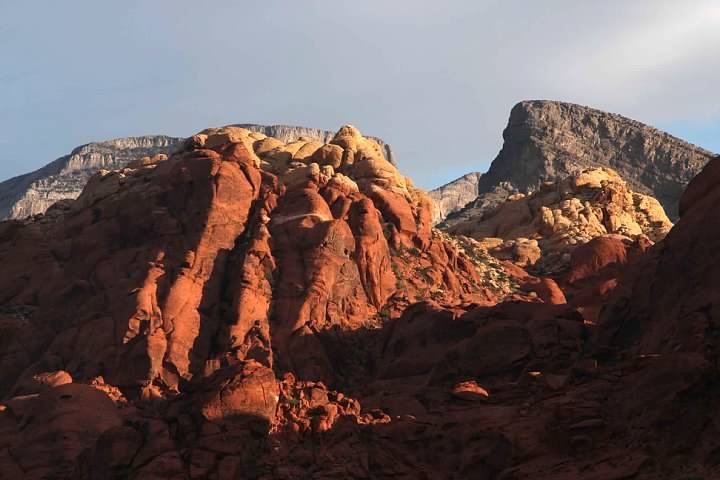 The sun just beginning to catch the Calico Hills, with Turtlehead Peak looming beyond at right