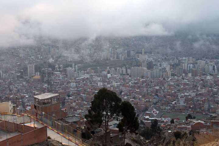 First look at La Paz from the heights of El Alto. The road down is visible at lower left