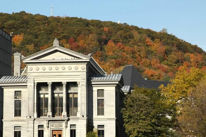 Redpath Museum, located on the campus of McGill University with Mont Royal looming behind. Lowell Silverman photography, 2015