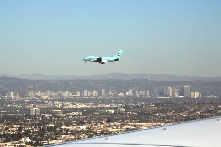 A Korean Air plane approaching LAX to land on a parallel runway to ours
