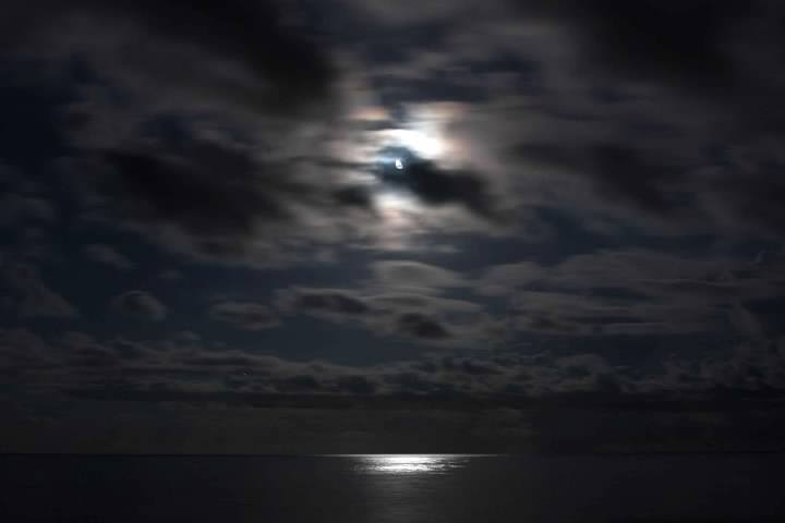 Calm before the storm: The moon illuminating the Atlantic Ocean. 10:28pm EDT, 8 second exposure @ f4, ISO-400, focal length 24mm