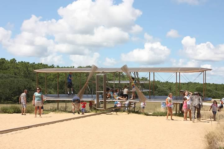 A metal sculpture representing the Wrights' first flight is popular with children