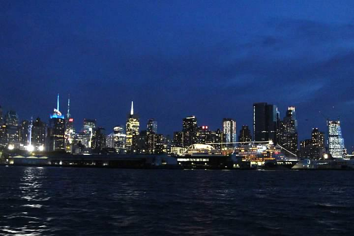 Lights of Manhattan and cruise ships docked to the north of Pier 83