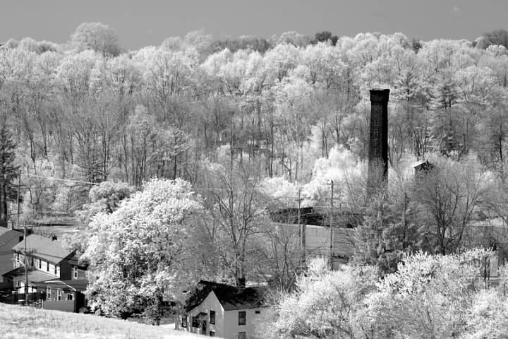 The factory seen from the Newark Reservoir in April 2007. The homes in the foreground (three of them at least) were built in 1892 as housing for mill workers and are on the National Register of Historic Places. Infrared